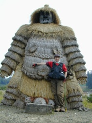 mary-poses-next-to-kashima-sama-a-gigantic-straw-god-of-war-wearing-the-mask-of-the-namahage-mountain-spirit-copy